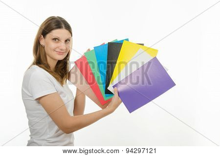 Young Girl Holding A Picture With Solid Colors