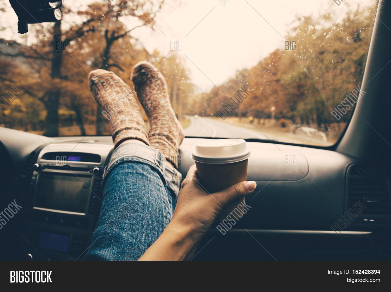 Woman Feet In Warm Socks On Car Dashboard Drinking Take Away Coffee Road