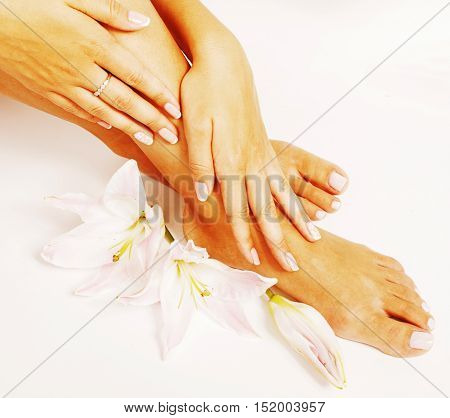 manicure pedicure with flower lily close up isolated on white perfect shape hands spa salon, mani pedi concept