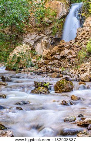 Waterfall in autumn forest at Vancouver, Canada. Hardy Falls, Okanagan Lake, Kelowna.