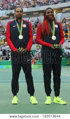 RIO DE JANEIRO, BRAZIL - AUGUST 14, 2016: Silver medalists Rajeev Ram (L) and Venus Williams of United States during medal ceremony after mixed doubles final of the Rio 2016 Olympics
