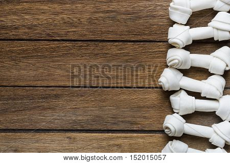 dog bone on old wooden table, top view