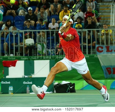 RIO DE JANEIRO, BRAZIL - AUGUST 8, 2016: Olympic champion Rafael Nadal of Spain in action during men's doubles round 2 of the Rio 2016 Olympic Games at the Olympic Tennis Centre