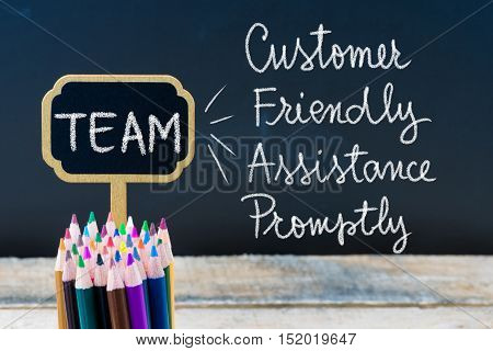 Business Acronym Team Customer Friendly Assistance Promptly Written With Chalk On Wooden Mini Blackb