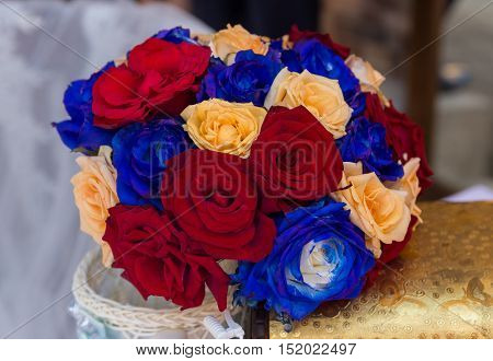 Nice wedding bouquet with red, blue and yellow flowers