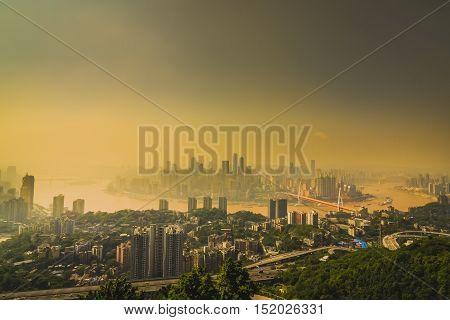 Chongqing, China downtown city skyline over the Yangtze River.