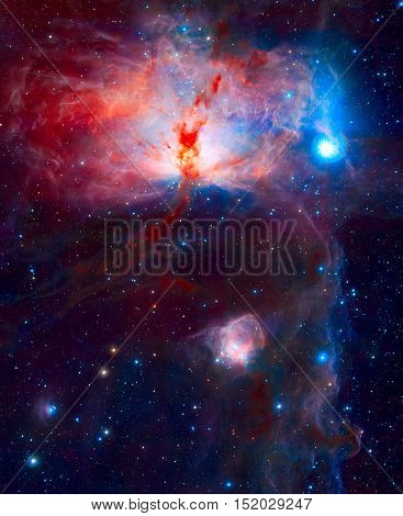 The spectacular star-forming region known as the Flame Nebula, or NGC 2024, in the constellation of Orion. The Flame Nebula is include the Horsehead Nebula. Elements of this image furnished by NASA.