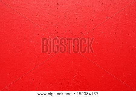 Red painted wall surface with texture pattern