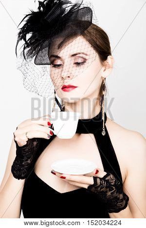 glamor girl with a cup of coffee. fashion woman drinks coffe or hot tea. poster