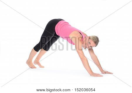 Woman In Yoga Pose On Hands And Feet