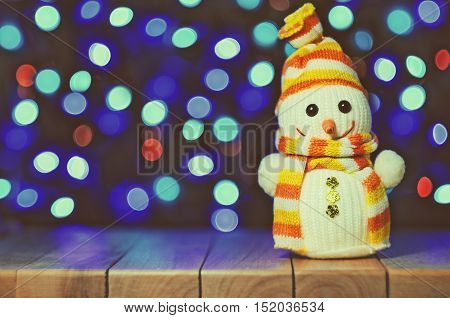 Vintage Snowman With Lights In The Background