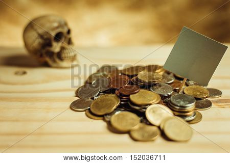 Focus In Label Gray.pile Of Money, Thai Coins Of One Bath On Wood And Skull Background.concept Of Fi