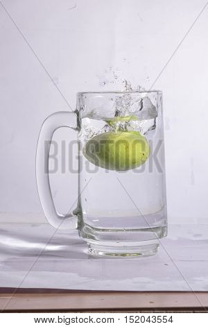 water, glass, splash, splashing, clear, cold, liquid, health, white, droplet, flow, water bottle, light, alcohol, smooth, wave, flowing, energy, welling, drop, color, motion, transparency, refreshment, ripple, image, simplicity, bubble, closeout, isolated