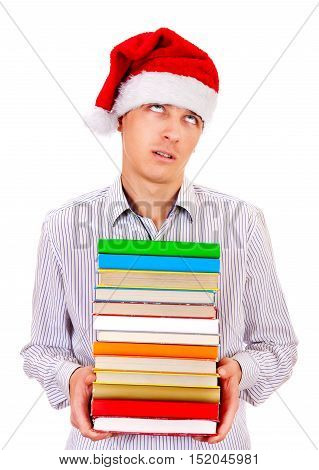 Annoyed Student in Santa Hat with a Books on the White Background