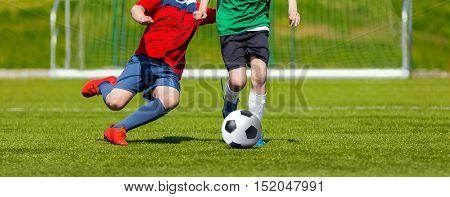 Boys kicking soccer ball. Youth soccer game for kids