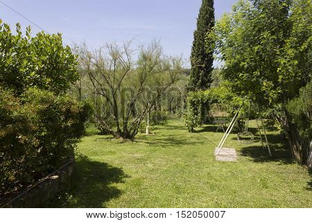 FLORENCE, ITALY - MAY 21 2016: Seasaw and green gazebo in the backyard of a restaurant on florentine hills