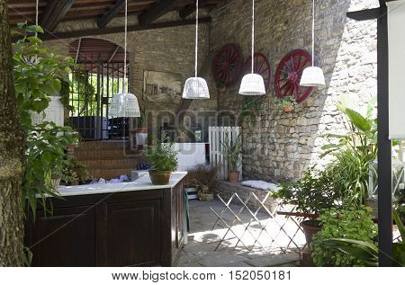 FLORENCE, ITALY -MAY 21 2016: Traditional bar countertop in the outdoors of a rustic restaurant with exposed beams near Florence Italy