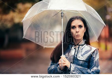 Funny Woman with Transparent Raincoat and Umbrella