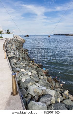Panama City Panama- June 08: trash floating on a protected cove viewed form the Urraca Park in Panama. June 08 2016 Panama City Panama.