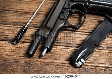 Disassembled pistol, gun maintenance concept