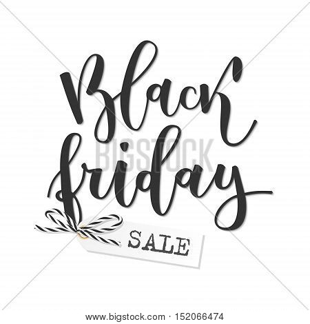 Black friday sale hand written inscription with label tied up with bakers twine bow on white background