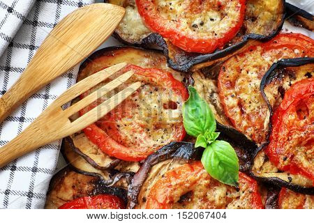 Delicious vegetarian pizza background, roasted aubergine with tomatoes and basil on the plate on the wooden table, healthy and tasty eating, Thanksgiving homemade food