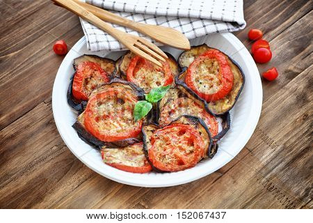 Baked eggplant with tomatoes as tasty vegetarian pizza topping, main course in a holiday day, traditional italian food, Thanksgiving homemade food