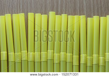 Drink tube of yellow color in abstract background for the design idea backdrop.