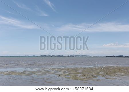 Sea coast and dry water in sunny on blue sky backgroundSeaboard in Thailand.