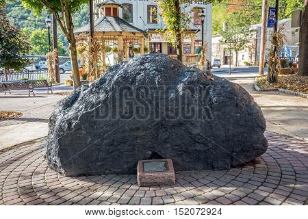 JIM THORPE PENNSYLVANIA - SEPTEMBER 28: A large anthracite coal boulder on display in the town center on September 28 2016 in Jim Thorpe Pennsylvania.