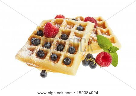 Handmade Belgian waffles with blueberries, raspberries and powdered sugar isolated on white background