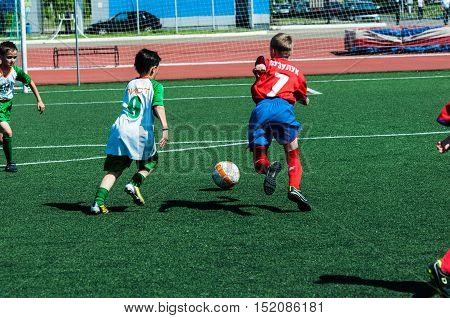Orenburg, Russia - 31 May 2015: Boys And Girls Play Soccer
