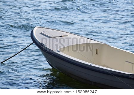 Closeup of a small white boat floating on the water