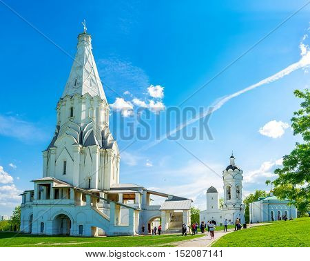 MOSCOW RUSSIA - MAY 10 2015: The view on Ascension Church in Kolomenskoye one of the first tent-roof stone churches in Russia located next to St George bell tower Water Tower and Hunting Pavilion on May 10 in Moscow.