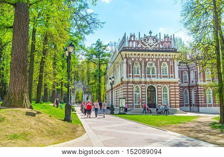 MOSCOW RUSSIA - MAY 10 2015: The facade of the Small Palace (Semicircular Palace) of Tsaritsyno Royal Estate decorated with white patterns Gothic elements and Double-Headed Eagle on the top on May 10 in Moscow.