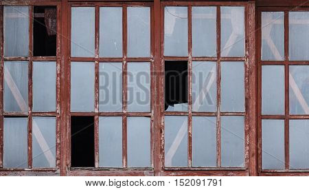 broken glass window ruins in an abandoned old house background
