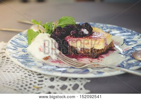 Blueberry cake with blueberry sauce. homemade blueberry cake with whipped cream. fresh blueberry sweet sauce.(vintage effect and selective focus)