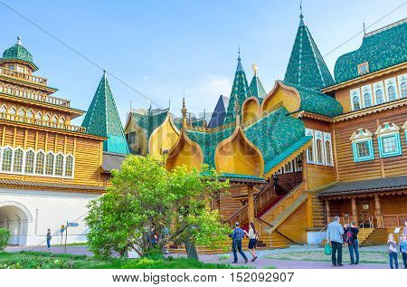MOSCOW RUSSIA - MAY 10 2015: The scenic porch of the wooden Palace of Tsar Alexei Mikhailovich with the figured canopy covered with tiles on May 10 in Moscow.