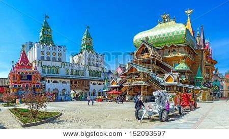 MOSCOW RUSSIA - MAY 10 2015: Panorama of the central square of Izmailovsky Kremlin with the timbered Tsar's Palace and huge decorative central gate with green towers on May 10 in Moscow.