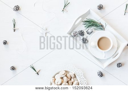 Christmas composition. Winter breakfast. Cup of coffee cones christmas tree branchs. Top view flat lay