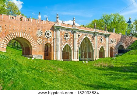 Panorama of the Big Bridge over the Ravine with various arches slender pillars rosette patterns and fretwork Tsaritsyno Moscow Russia.