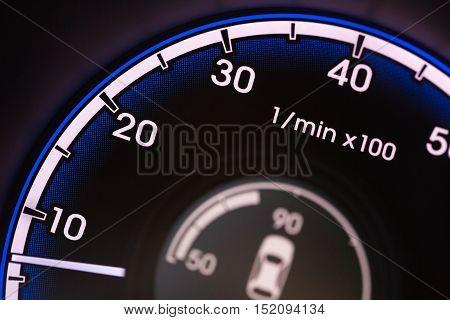 Close up Detail of a Tachometer in a Car