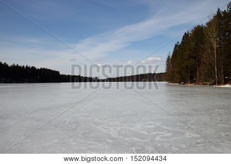 frozen lake in the woods. Natural ice rink