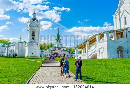 MOSCOW RUSSIA - MAY 10 2015: Discovering of Kolomenskoye Royal Estate the view on porch of the Church of Ascension Palace Gate St George Bell Tower on May 10 in Moscow.