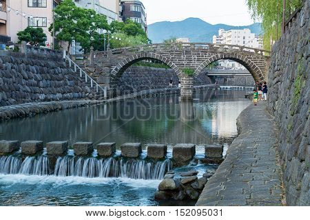 Nagasaki, Japan - July 19, 2014 : Meganebashi (Spectacles Bridge) in Nagasaki, Japan. It's a oldest stone arch bridge in Japan, and has been designated as an Important Cultural Property.