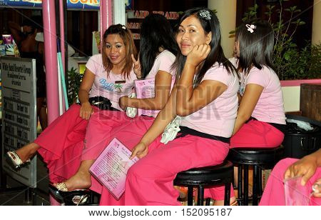 Phuket Thailand - January 10 2011: Thai women wearing pink hostess uniforms at a local massage spa in Patong City