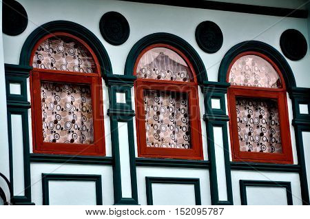Phuket City Thailand - January 8 2011: Finely restored early 20th century Sino-Portuguese shop house on Krabi Road in the historic district