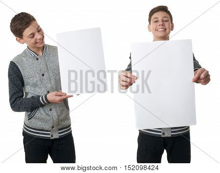 Set of cute teenager boy in gray sweater holding paper bill board over white isolated background, half body