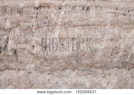 textures and brown cracks of a stone outdoor