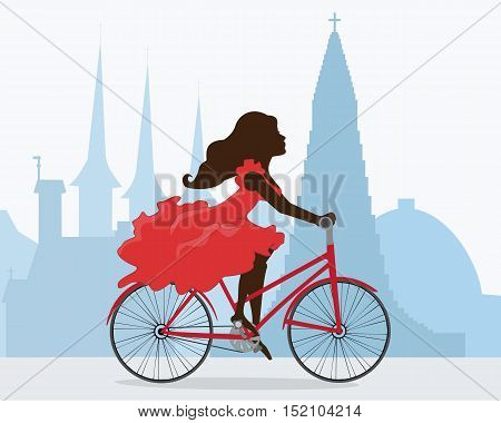 A woman rides a bike through the capital of Iceland. Behind the girl the silhouette of the Cathedral Hallgrimskirkja, Perlan and other attractions of Reykjavik. Vector illustration. Horizontal.